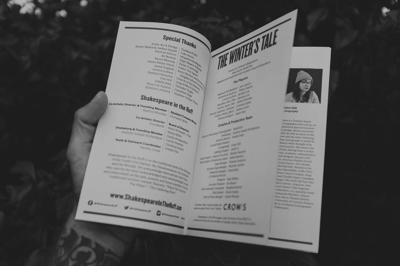 Black and white image of a hand holding the program booklet for The Winter's Tale
